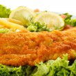 Fish dish - fried fish fillet, French fries with vegetables — Stock Photo #11417755
