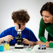 Royalty-Free Stock Photo: Boy examining preparation under the microscope