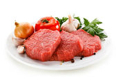 Raw beef and vegetables on white — Stock Photo