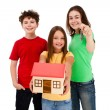 Kids holding model of house isolated on white background — Stock fotografie #11835228