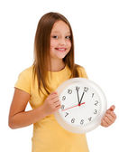 Girl holding wall-clock isolated on white background — Stockfoto