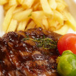 Steak with French Fries - Stock Photo