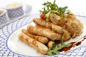 Sausage with cabbage — Stock Photo