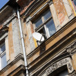Stock Photo: Old tenement and antenna