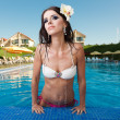 The beautiful girl in pool — Stock Photo