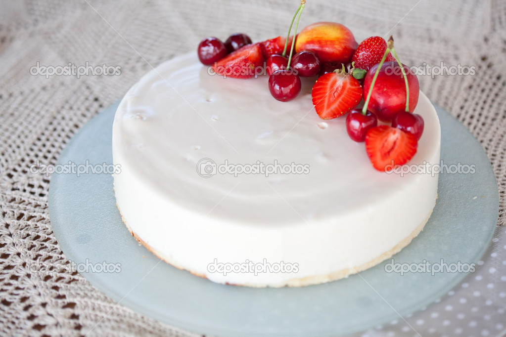 White Cream Icing Cake with red Fruits  Stock Photo #11031919