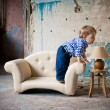 Adorable baby in the chair — Stock fotografie