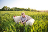 Little boy sits in chair — Stock Photo