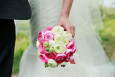 Wedding bouquet in the bride's hands — Stock Photo