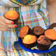 Female hand picking a muffin — Foto de Stock