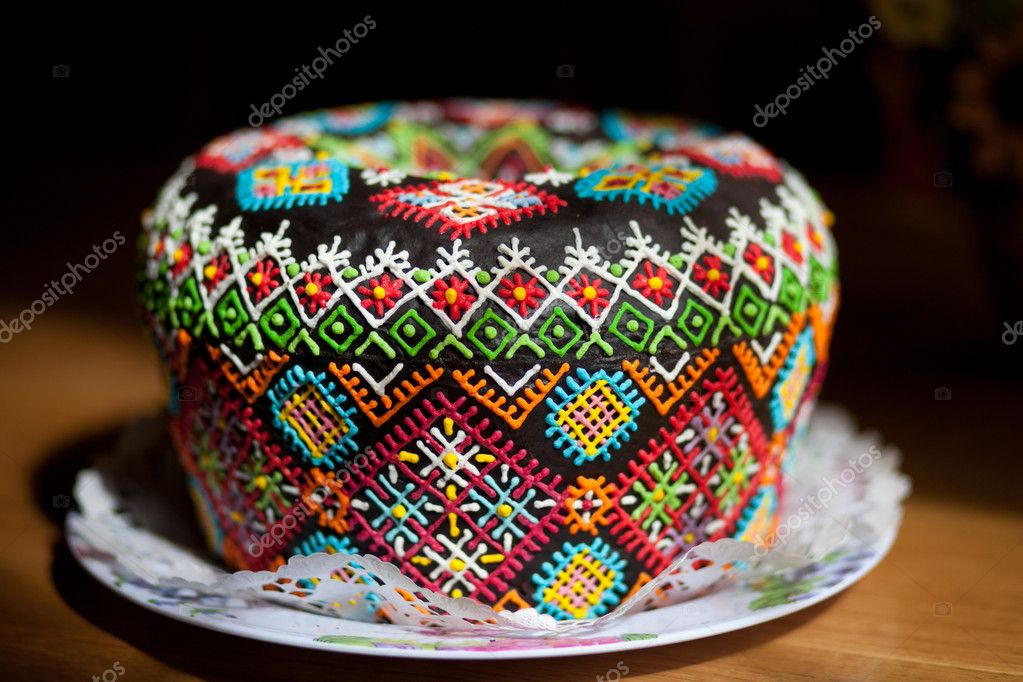 Easter cake kulich or panettone on festive Easter table — Stock Photo #11936521