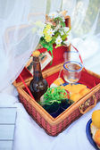 Picnic basket - fruits, bread and wine — Stock Photo
