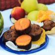 Picnic plate - fruits, muffins — Stock Photo