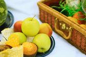 Picnic basket - fruits, muffins — Stock Photo