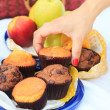 Female hand picking a muffin — Stockfoto