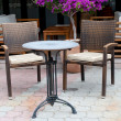Stock Photo: Chairs and table on the sidewalk