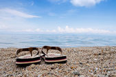 Thongs on the beach — Stock Photo