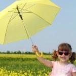 Happy little girl with yellow umbrella — Stock Photo