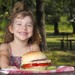 Happy little girl picnic in park — Stock Photo