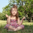 Stock Photo: Little girl meditates in nature