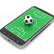 Football - soccer ball and mobile phone on white background — Stock Photo