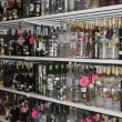 Stock Photo: Showcase of alcohol in duty-free shop