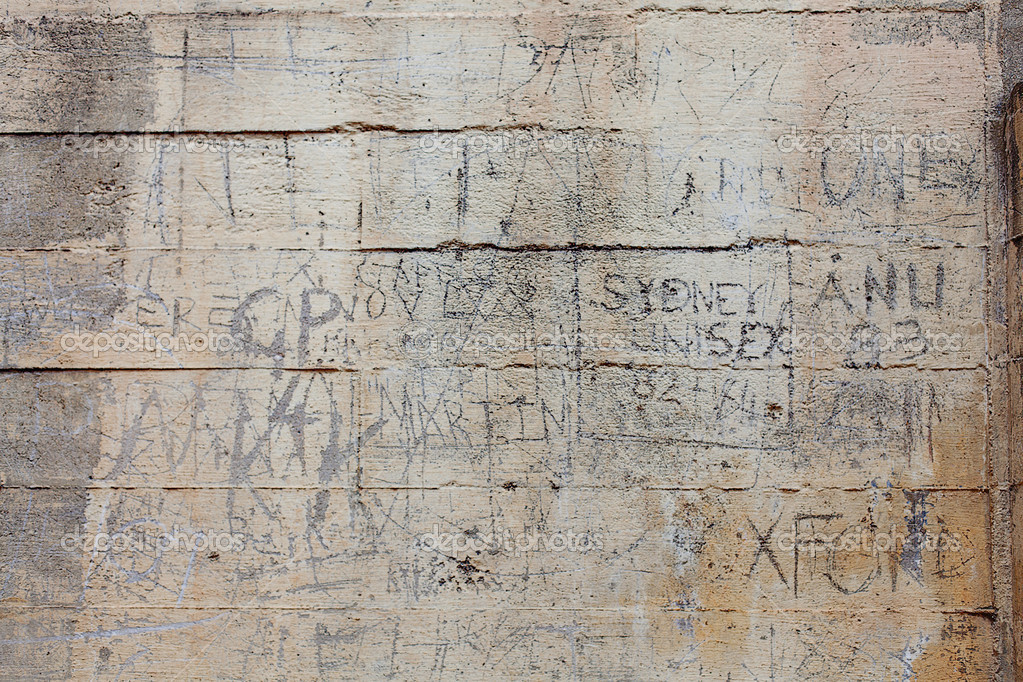 Vandalised Wall with words and letters carved into the concrete wall  Stock Photo #11947755