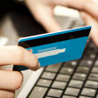 Online shopping with credit card on laptop — Foto Stock