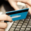 Online shopping with credit card on laptop — Stok fotoğraf
