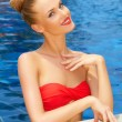 Glamorous woman posing in the pool - Stock Photo