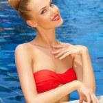 Glamorous woman posing in the pool — Stock Photo