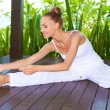 Stock Photo: Graceful woman stretching doing yoga