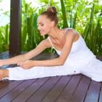 Graceful woman stretching doing yoga — Stock Photo