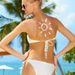 Woman with a sun painted on her back — Stock Photo #10862770