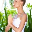Woman practising yoga and meditating — Stock Photo #10862794