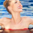 Pretty woman laughing while swimming — Stock Photo