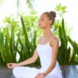 Woman in lotus position meditating — Stock Photo