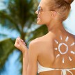 Smiling woman with the sun painted on her back — Stock Photo