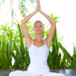 Woman doing yoga breathing exercises — Stock Photo