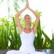 Woman doing yoga breathing exercises — Stock Photo