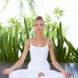 Woman meditating in the lotus position — Stockfoto