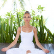 Woman meditating in the lotus position — Stock Photo #10863035