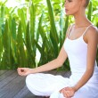 Woman in deep contemplation while meditating - Stock Photo