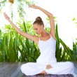 Стоковое фото: Woman doing yoga exercises