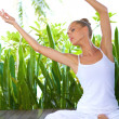 Woman doing yoga workout — Stock Photo