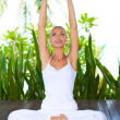 Woman practising yoga — Stockfoto