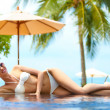 Stock Photo: Sexy womin bikini on infinity pool