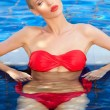 Pretty woman in a red bikini slightly upset - Stockfoto