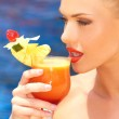 Woman sipping tropical cocktail — Stock Photo