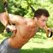 Attractive fittness man doing exercises - Stock Photo